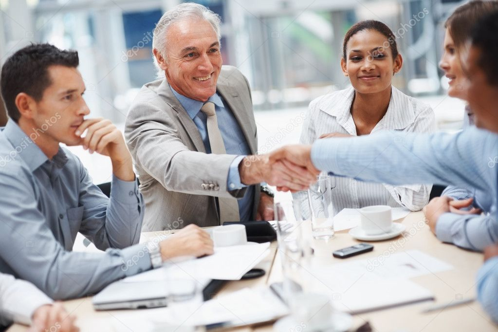 Good work - Senior business man congratulating a co worker during a meeting — Stock Photo #3366173