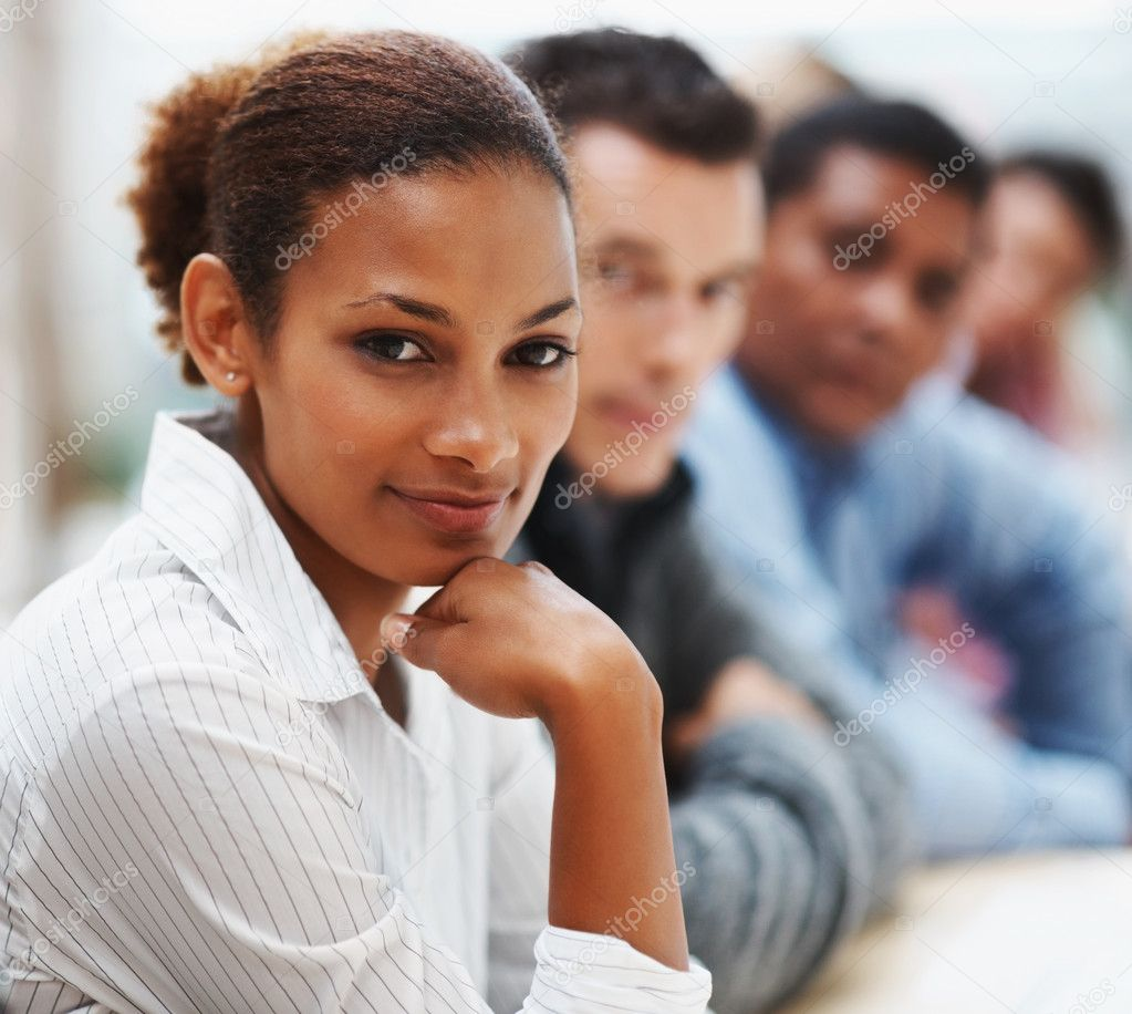 Portrait of a pretty African American business woman in a conference with colleagues — Foto de Stock   #3366208