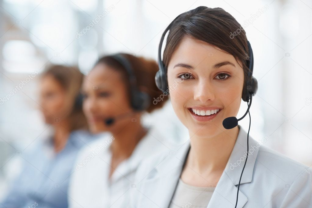 Closeup of a cute business woman with headset at workplace  Stock Photo #3366249