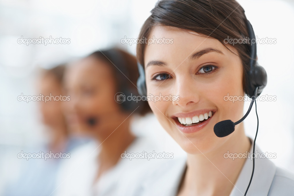 Closeup of a beautiful business customer service woman smiling — Stock Photo #3366253