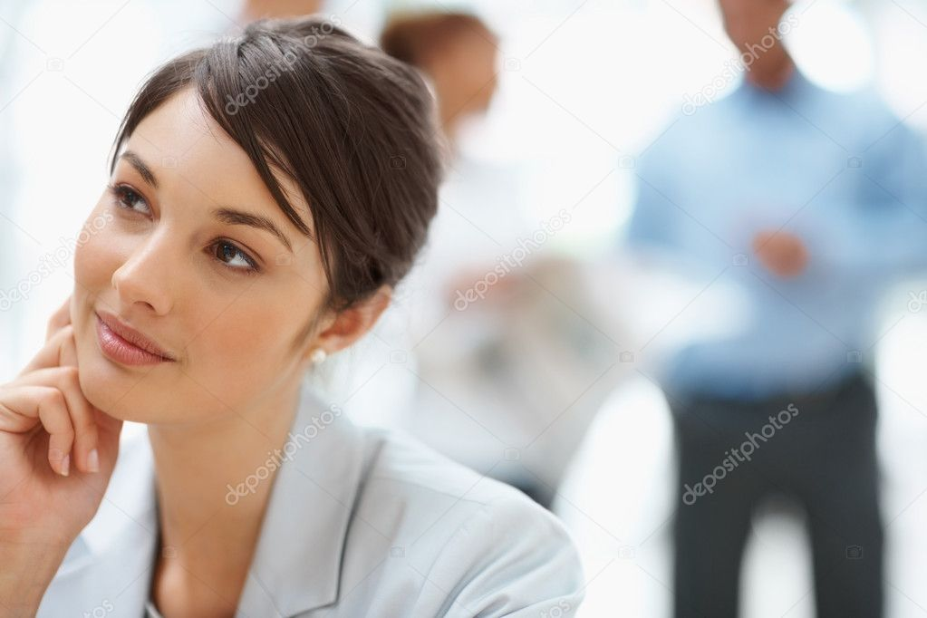 Portrait of a beautiful business woman thinking about something — Stock Photo #3366313