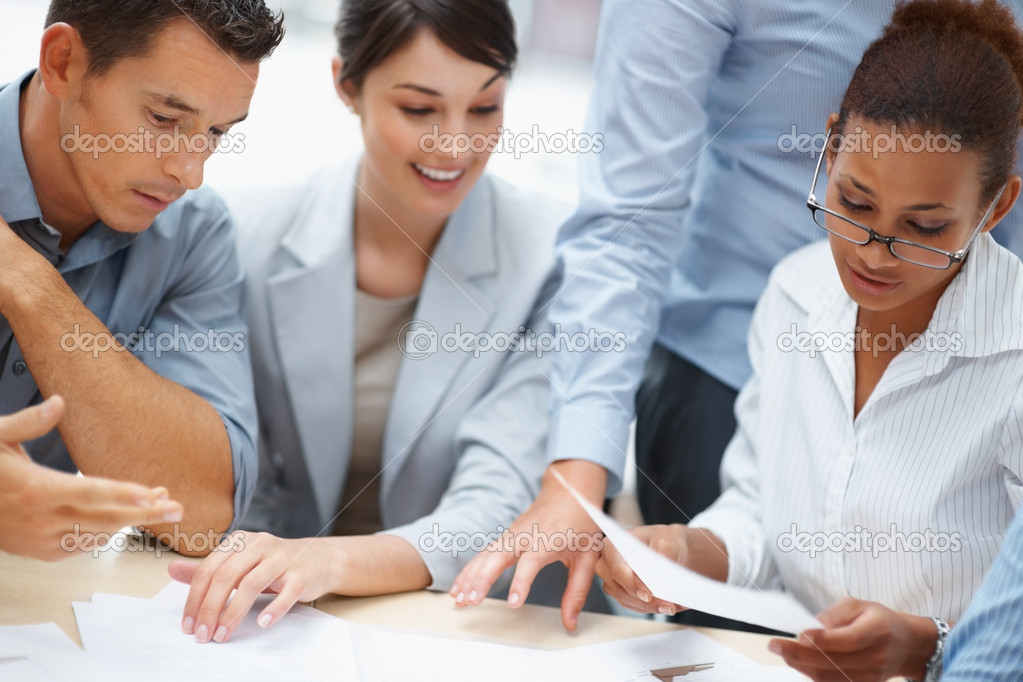 Successful group of business working on plans  Stock Photo #3366337