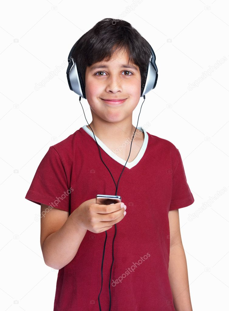 Smiling little boy enjoying music over the headphones on white  Stock Photo #3367036