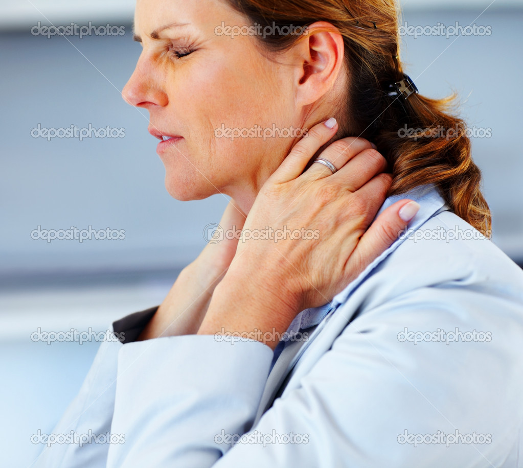 Portrait of young business woman suffering from severe neck pain — Stock Photo #3368479