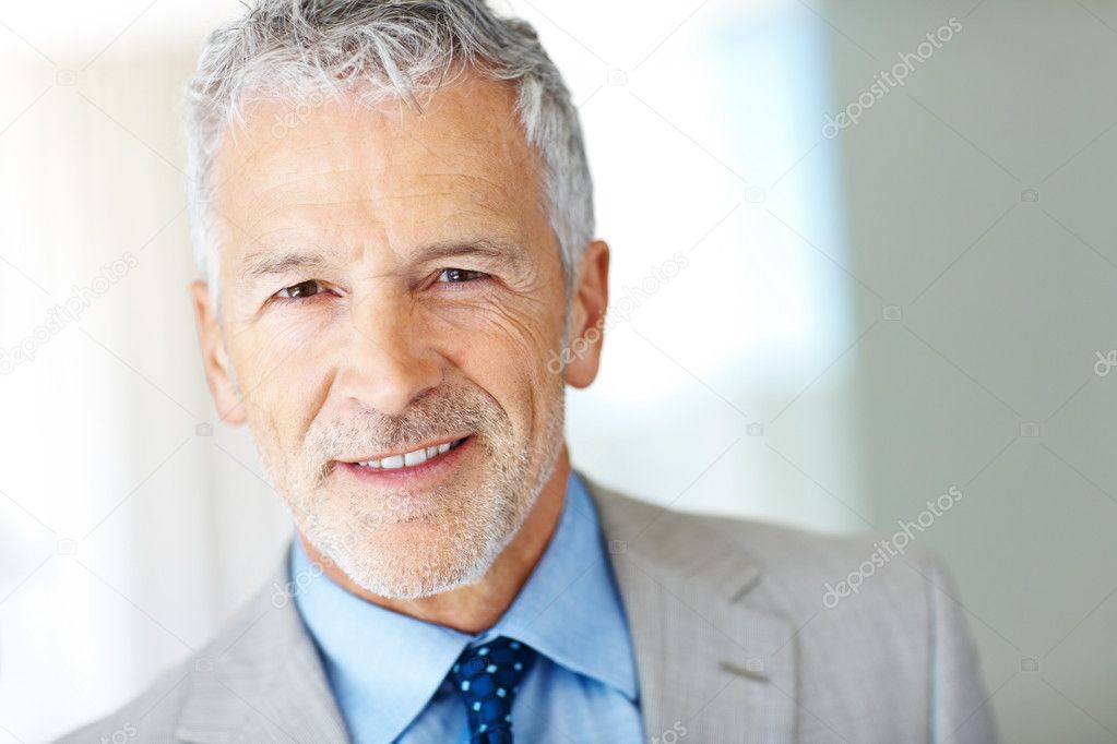 Closeup portrait of a handsome elderly business man smiling - Copyspace — Stock Photo #3369253