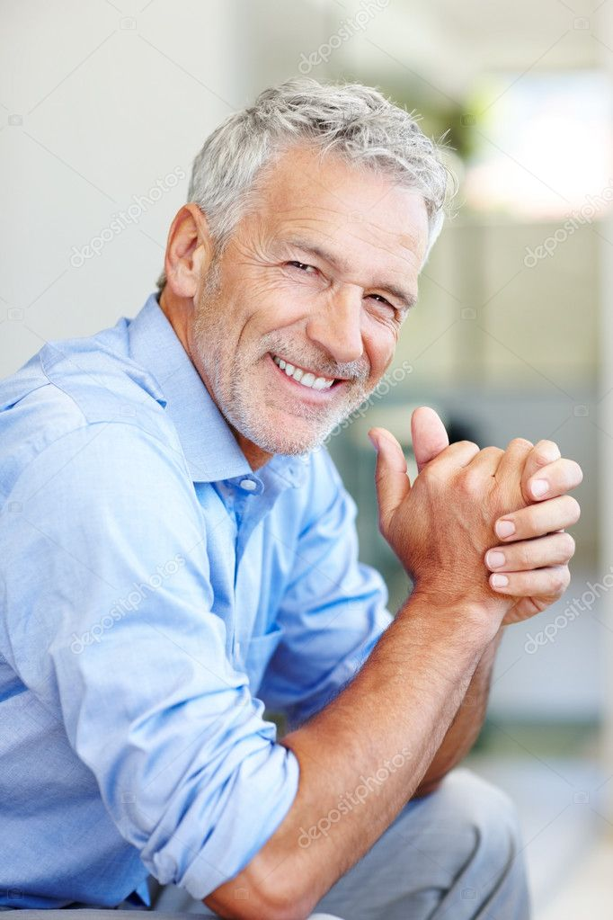 Portrait of a happy mature male entrepreneur smiling  Stock Photo #3369326