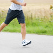 Royalty-Free Stock Photo: Low section image of a athlete jogging