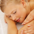 Closeup of a young female getting a massage treatment at a spa - Stock Photo