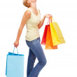Happy young female with shopping bags on white - Foto de Stock