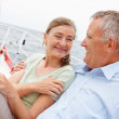 Royalty-Free Stock Photo: Mature couple enjoying on a boat while on a voyage