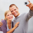 Royalty-Free Stock Photo: Charming young couple self photography