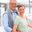 Royalty-Free Stock Photo: Retired couple posing on a sailboat