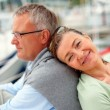 Royalty-Free Stock Photo: Senior woman smiling with her head on husband\'s back