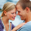 Closeup of a romantic young couple embracing outdoors - Stockfoto