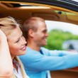 Young woman taking a drive with boyfriend in a car - Stock Photo