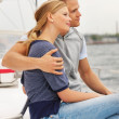 Royalty-Free Stock Photo: Happy young couple enjoying a sea voyage on a sailboat