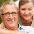 Closeup portrait of a cute elderly couple, outdoors - Stock Photo