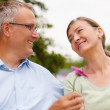 Royalty-Free Stock Photo: Retired man giving a flower to his wife