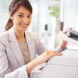 Happy business woman working on the photo copy machine - Stock Photo