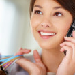Closeup of a pretty young woman speaking on cellphone - Stockfoto