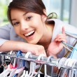 Pretty young woman shopping at the clothes shop - Stock Photo