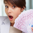 Royalty-Free Stock Photo: Surprised - Female with fan of five hundred Euros