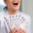 Pretty woman with currency notes on white - Foto Stock