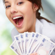 Happy woman with a fan of currency notes , Japanese currency - Stockfoto