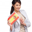 Pretty female holding Spain&#039;s flag over white background - 