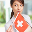 Patriotic woman with Switzerland's flag , looking away - Stock Photo