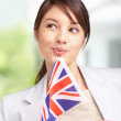 Pretty young female looking away , with a british flag - Stockfoto