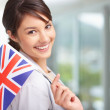 Pretty young female with Great Britain&#039;s flag - Foto Stock