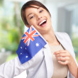 Pretty young woman with Australia&#039;s flag - Stockfoto