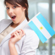 Cute young female with an argentinian flag - Stock Photo