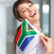 Royalty-Free Stock Photo: Lovely young woman with a South African flag