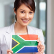 Attractive young woman with a South African flag - Stock Photo