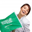 Carefree young female holding a Saudi Arabian flag on white - Stock Photo