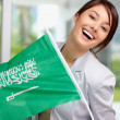 Lovely young female holding a Saudi Arabian flag , smiling - 
