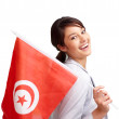 Carefree young female holding a Tunisian flag on white - Stock Photo