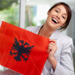 Royalty-Free Stock Photo: Cute young female displaying an Albanian flag