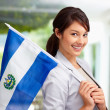 Royalty-Free Stock Photo: Cute young female with an El Salvadorian flag