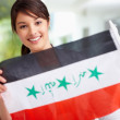Royalty-Free Stock Photo: Pretty young female displaying an Iraqi flag
