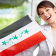 Royalty-Free Stock Photo: Lovely young woman displaying an Iraqi flag