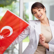 Royalty-Free Stock Photo: Beautiful young woman displaying a Turkish flag