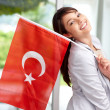 Pretty young female holding a Turkish flag - Stock Photo