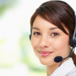 Cute young woman wearing a headset , call centre - Stock Photo