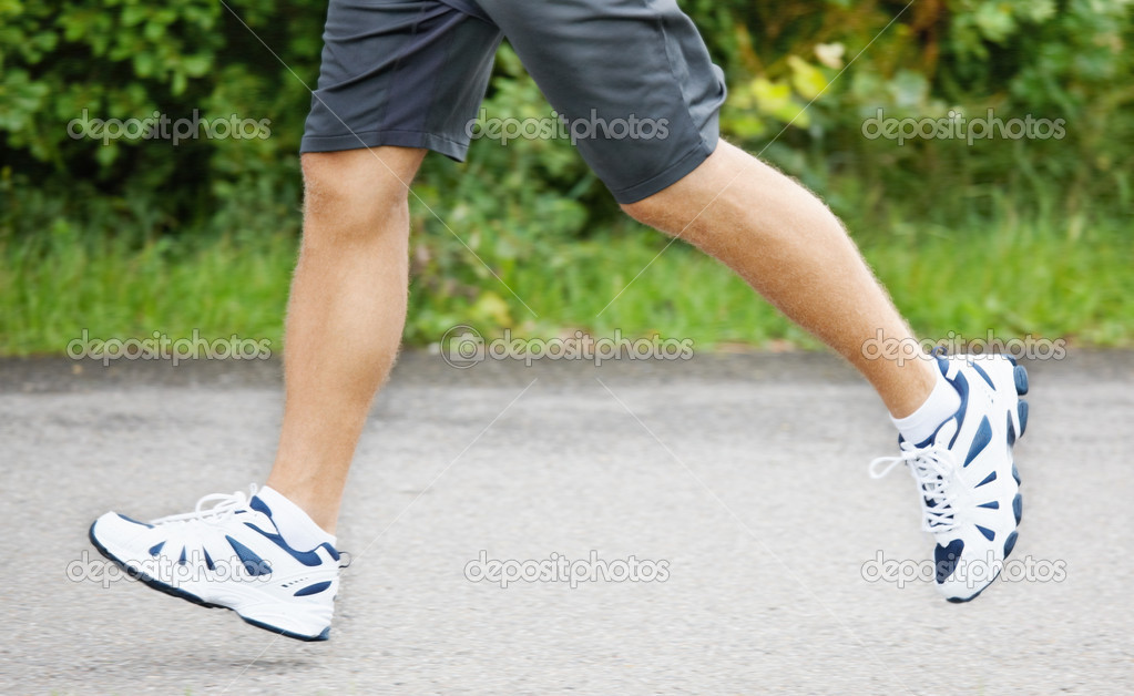 Low section image of a male athlete during a run — Stock Photo #3405593