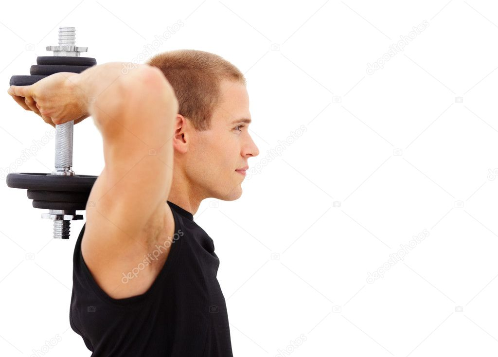 Profile view of a young man working on his triceps using a dumbbell, isolated on white — Stock Photo #3406139