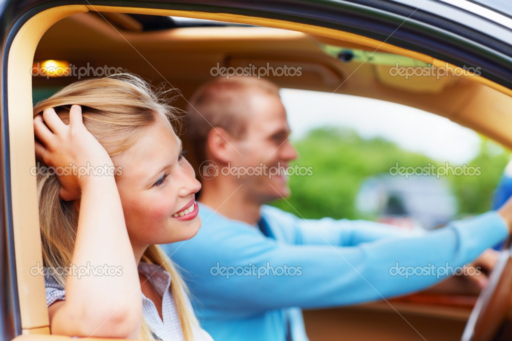 Attractive young woman enjoying a long drive in their new car — Stock Photo #3407555