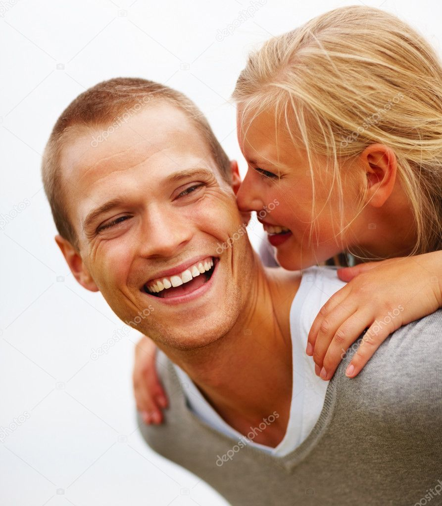 Closeup portrait of a cute young couple smiling outdoors  Stockfoto #3407854
